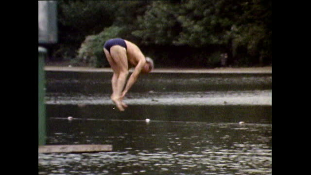 older man dives into the serpentine lake in hyde park; 1971 - semi dress stock videos & royalty-free footage