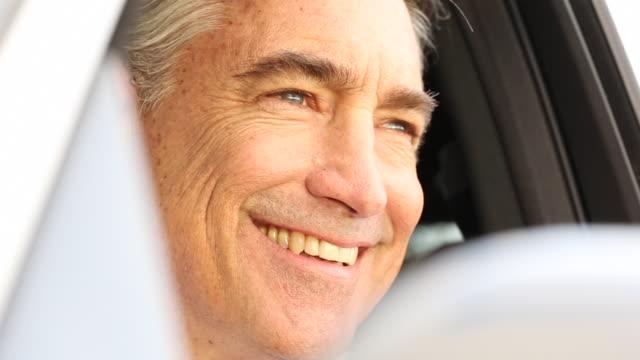 stockvideo's en b-roll-footage met a older man driving in a expensive vehicle in a rural area. - 55 59 jaar