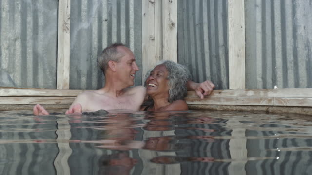 4K UHD: Older Man Grabs a Smooch from His Wife While Soaking in a Hot Spring