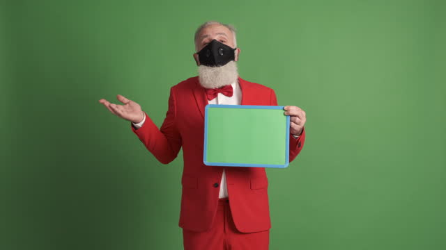 older man  in protective face mask shows  green poster and makes a sad gesture - shirt and tie stock videos & royalty-free footage