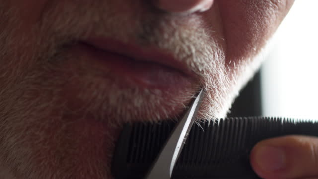 older man trimming his moustache during quarantine isolation - moustache stock videos & royalty-free footage