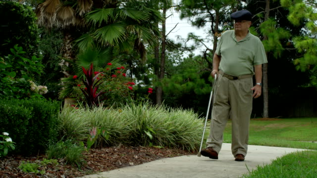 older man walking with injuries - walking cane stock videos and b-roll footage