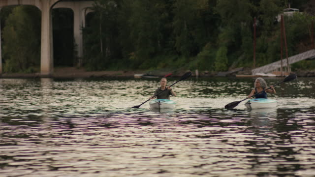 older mature couple kayaking together during summer - fatcamera stock videos and b-roll footage