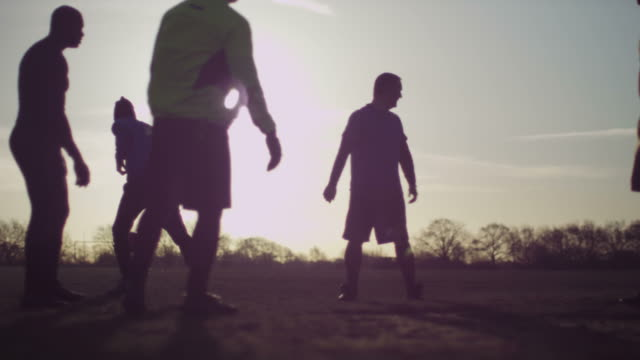 older men keeping fit playing football in nature - hobbies stock videos & royalty-free footage