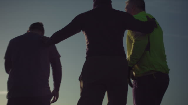stockvideo's en b-roll-footage met older men keeping fit playing football in nature - mid adult men