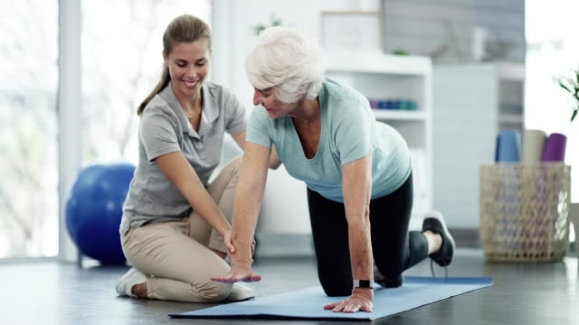older people gain the most benefit from exercise - physical therapist stock videos & royalty-free footage