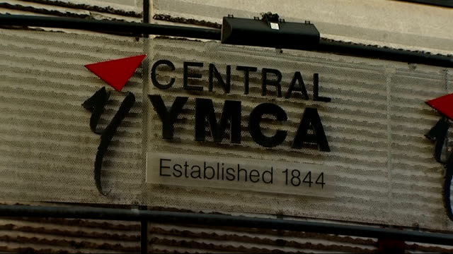 Older people taking part in Keep Fit class at YMCA centre EXT YMCA entrance / 'Central YMCA' sign / 'Join Free' sign / 'Central YMCA' sign