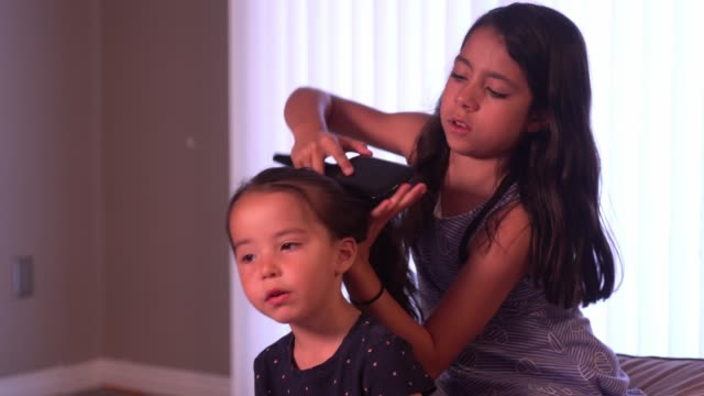 older sibling duties - braided hair stock videos & royalty-free footage