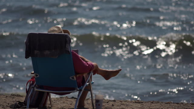 older woman on beach in lounge chair - new london county connecticut stock videos & royalty-free footage