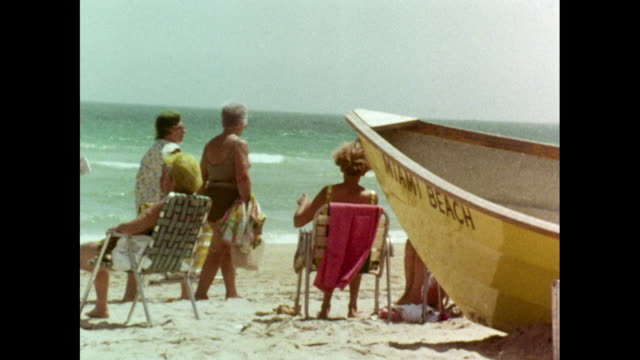 older women relaxing on miami beach in 1969 - sunbathing stock videos & royalty-free footage
