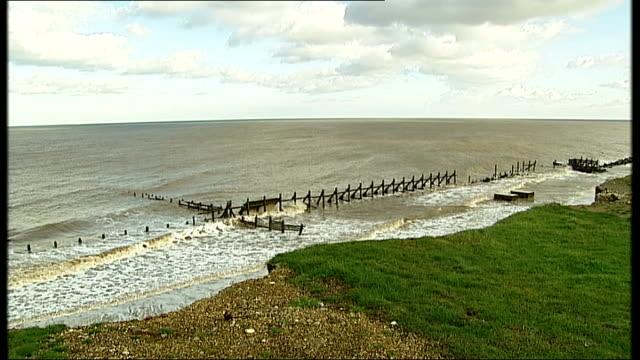 oldest human footprint outside africa found on norfolk beach; england: norfolk: happisburgh: ext clouds in blue sky tilt down sea waves hitting land... - イーストアングリア点の映像素材/bロール