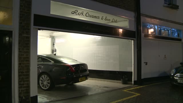 Oldest Jaguar dealership R A Creamer to close Sign on window Mechanic TILT DOWN engine Mews with cobble stones road Car in Mews garage INT Mechanic...