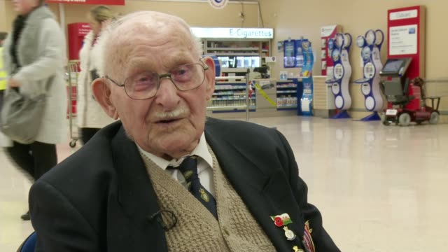 oldest poppy seller ron jones; ron jones interview sot - remember wife put me in the bath on first night home, was like a boy from belsen, and she... - selling stock videos & royalty-free footage