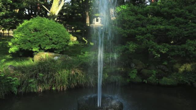 ms tu oldest water fountain in japan continues functioning at kenrokuen in kanazawa / kanazawa, ishikawa, japan - kanazawa stock videos and b-roll footage