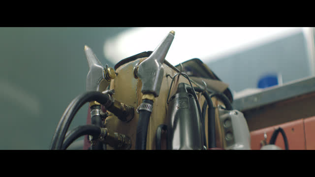 old-fashioned barber's clippers hang on hooks in a small town barber shop. - anamorphic stock videos and b-roll footage
