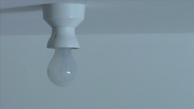 cu, old-fashioned light bulb being replaced by modern low-energy bulb - energy efficient lightbulb stock videos & royalty-free footage