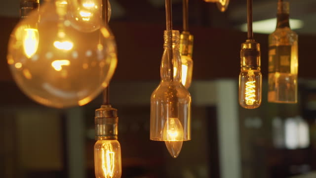 old-fashioned light bulbs and beer bottle bulb - medium group of objects stock videos & royalty-free footage