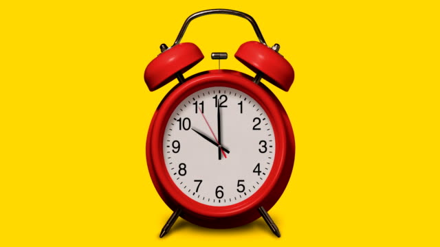 vídeos de stock e filmes b-roll de old-fashioned red alarm clock rings at 10 o'clock on yellow background - 10 seconds or greater