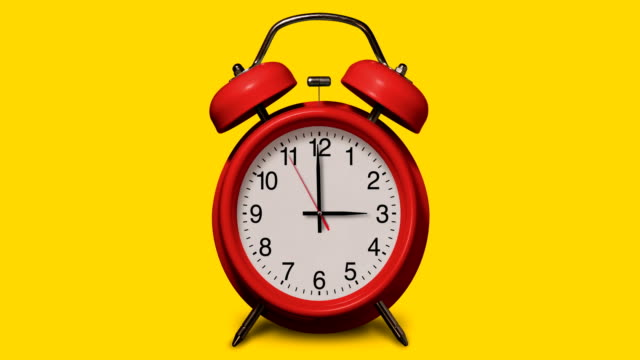 vídeos de stock e filmes b-roll de old-fashioned red alarm clock rings at 3 o'clock on yellow background - número 3