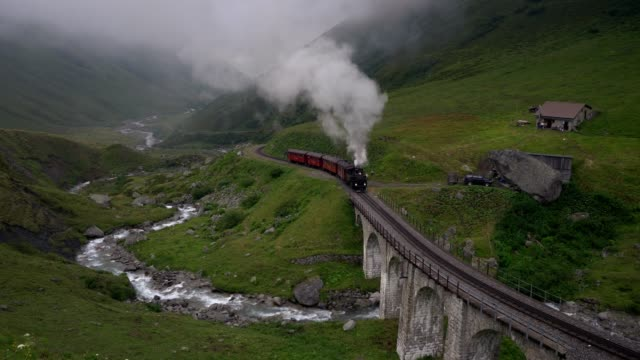 old-fashioned steam train in swiss alps - locomotive stock videos & royalty-free footage