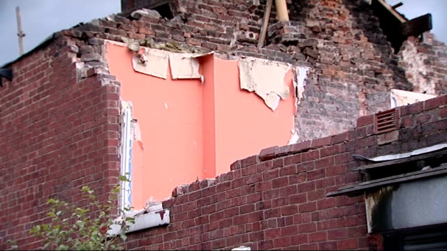 ext smashed windows of derelict house seen through wire fencing and torn plastic bags partially demolished house professor ian cole interview sot... - metal blend stock videos and b-roll footage