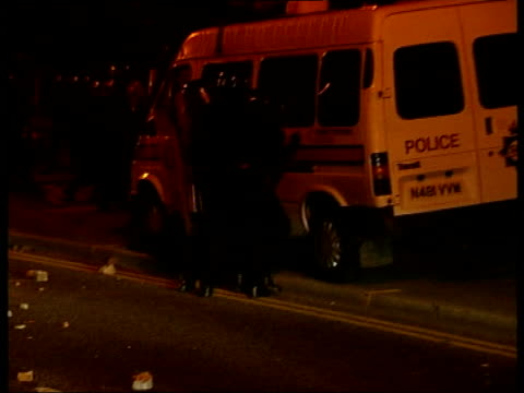 Oldham BVs Line of riot police across road as petrol bombs bricks fireworks thrown by rioting Asian youths BV Line of riot police running along...
