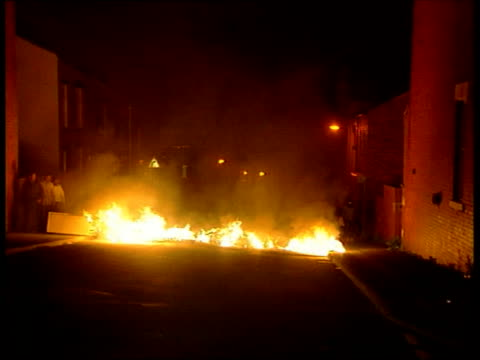 aftermath int philip hirst interviewed sot hasn't stopped the paper coming out trying to suppress a newspaper by firebombing it the sort of thing... - national front stock videos and b-roll footage