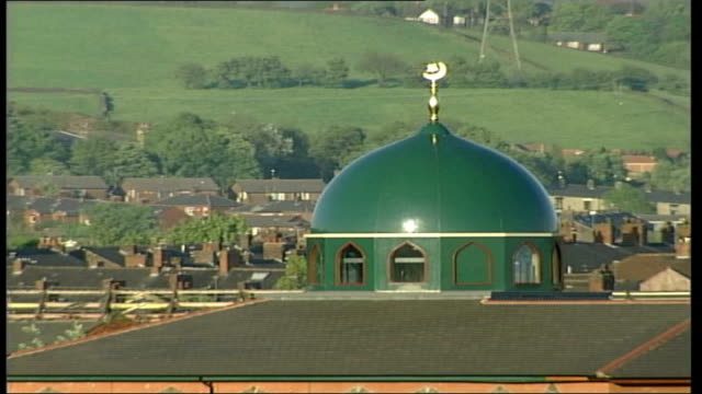 The aftermath Skyline ITN ENGLAND Oldham EXT / Dome of mosque rooftops and hills beyond / Oldham skyline including dome of mosque industrial chimney...