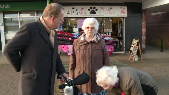oldham west and royton byelection campaign int wayne harling interview sot older woman with trolley along past ukip vox pops various shots queen... - queen elizabeth hall stock videos and b-roll footage