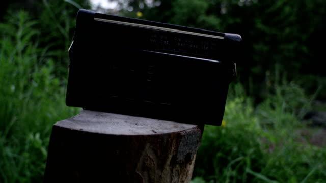 oldschool radio. camping equipment - radio broadcasting stock videos and b-roll footage
