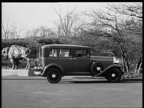 b/w 1928 oldsmobile car stopping + 2 flappers get out / industrial - 1928 stock videos & royalty-free footage