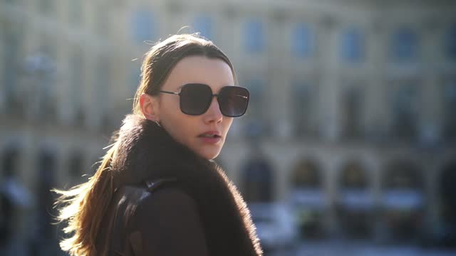 olesya senchenko wears sunglasses from dior, a brown leather long winter coat with fluffy collar from nour hammour, a black wool turtleneck pullover... - long hair stock videos & royalty-free footage