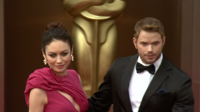 Olga Kurylenko and Kellan Lutz 86th Annual Academy Awards Arrivals at Hollywood Highland Center on March 02 2014 in Hollywood California
