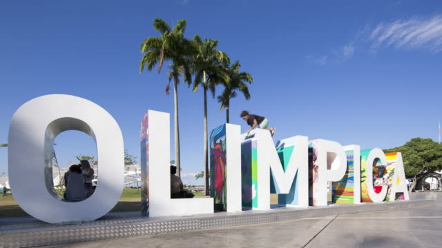 TL, WS Olimpica sign with people moving around it / Rio de Janeiro, Brazil