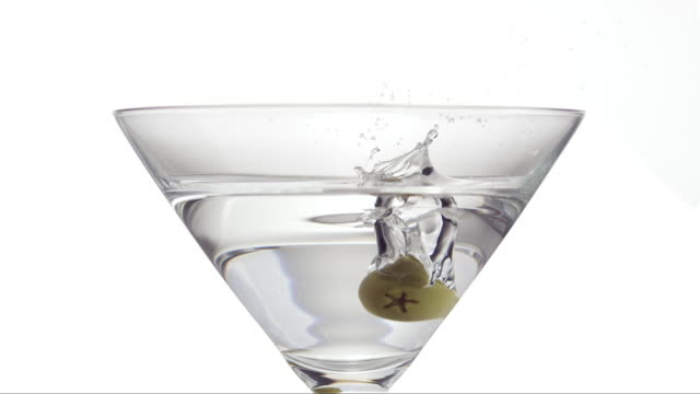 olive is falling into martini - martini stock videos & royalty-free footage