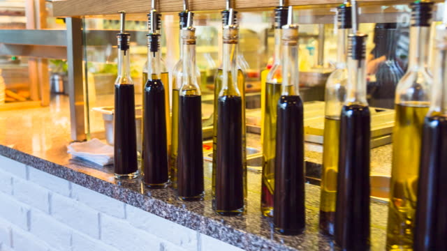 cu pan olive oil and balsamic vinegar bottles in restaurant - olive oil stock videos & royalty-free footage