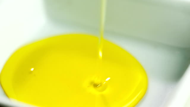 hd olive oil falling in square bowl - olive oil stock videos & royalty-free footage