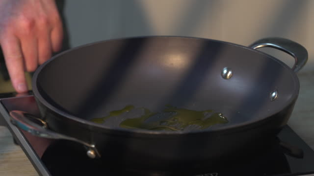 olive oil in cooking pan - black olive stock videos & royalty-free footage