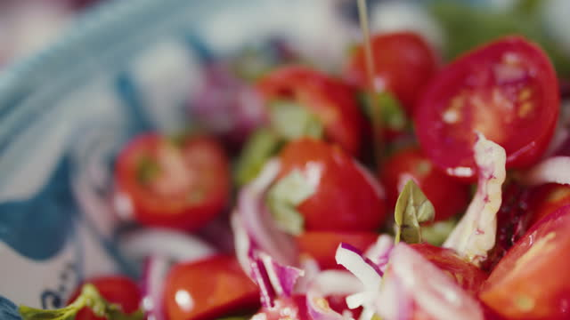 olive oil pouring on tomato salad - mediterranean culture stock videos & royalty-free footage