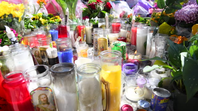 Olive Park Memorial at the intersection of Yonge Street and Finch Avenue close to where the tragedy started Close up of candles and religious symbols