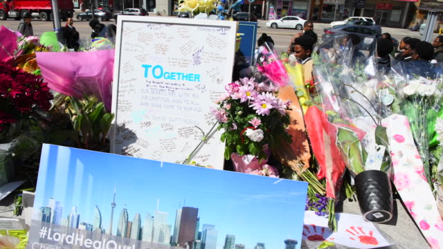 olive park memorial at the intersection of yonge street and finch avenue close to where the tragedy started the healing of a city after a mass murder... - toronto stock-videos und b-roll-filmmaterial