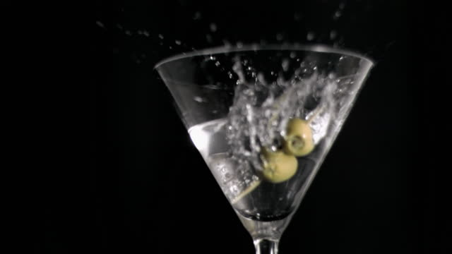 olive skewer falling in super slow motion in a glass - black olive stock videos & royalty-free footage