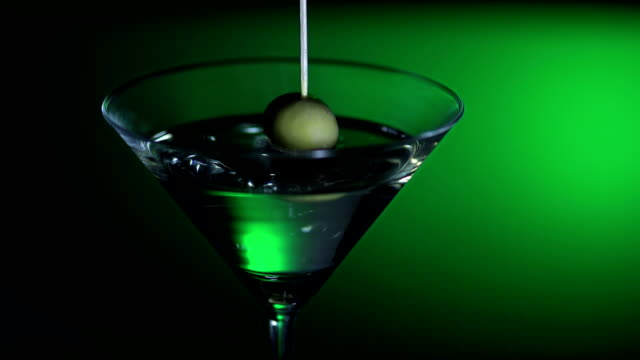 olive splashing into cocktail (super slow motion) - martini stock videos & royalty-free footage