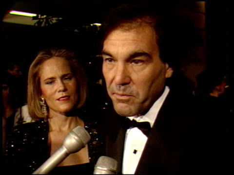 stockvideo's en b-roll-footage met oliver stone at the 1990 golden globe awards at the beverly hilton in beverly hills california on january 20 1990 - oliver stone
