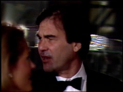 stockvideo's en b-roll-footage met oliver stone at the 1991 golden globe awards at the beverly hilton in beverly hills california on january 19 1991 - oliver stone