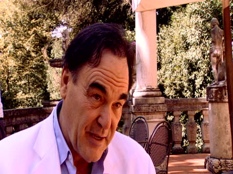 stockvideo's en b-roll-footage met oliver stone on how he deals with the subject of chavez in the film in particular about america's demonization of chavez and its enemies in general... - oliver stone