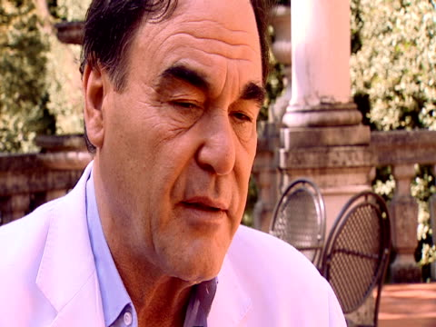 stockvideo's en b-roll-footage met oliver stone on how important it is for him as a filmmaker to get points across that mean something by making entertaining and palatable viewing he... - oliver stone