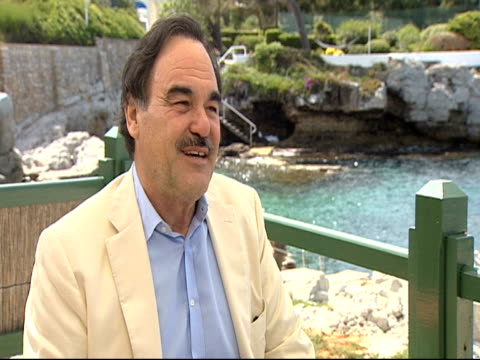 stockvideo's en b-roll-footage met oliver stone talks about how important it is for him to be a an educational director at the wall street money never sleeps interviews cannes film... - oliver stone