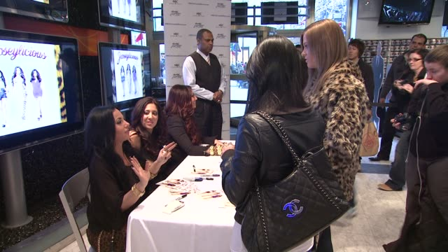 olivia blois sharpe gigi liscio tracy dimarco and fans at 'jerseylicious' cast meet greet on 3/7/2012 in new york ny united states - meet and greet stock videos and b-roll footage