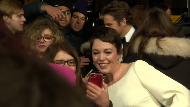 olivia colman and bradley cooper greeting fans on red carpet at bafta film awards at royal albert hall - red carpet event stock videos & royalty-free footage